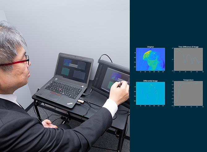 実験参加者の皮膚表面の体温変化をサーモカメラで計測し、データを解析しているイメージ